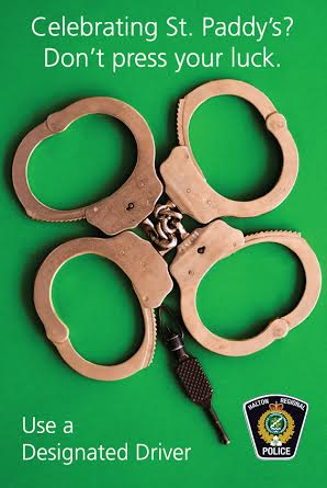 4 leaf clover made from hand cuffs with warning not to drink and drive